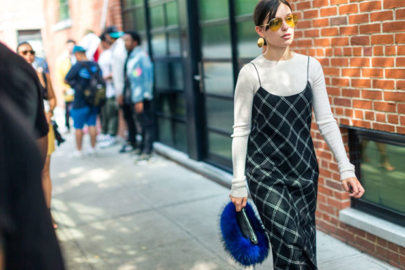 windowpane-prints-shirt-under-slip-dress-fall-work-outfit-furry-purse-fur-bag-nyfw-street-style-fall-outfits-hbz-585x390